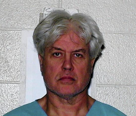 Allan Kustok is accused of killing his wife, Anita, in their Orland Park home.