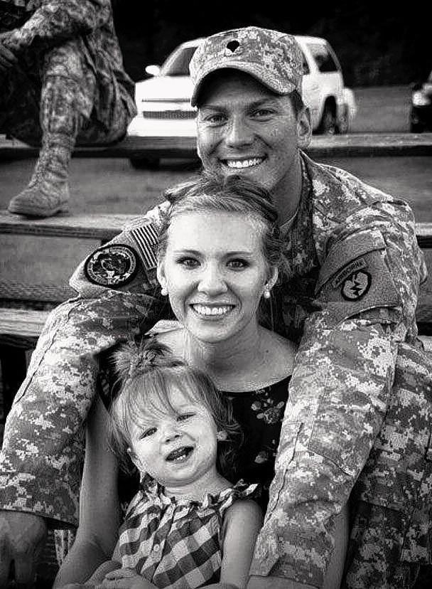 Chicago-area native Sgt. Okan Murat Cetinbag, pictured with his wife, Jazzmine, and daughter, Abbey Laine, 2, died Tuesday in Alaska.