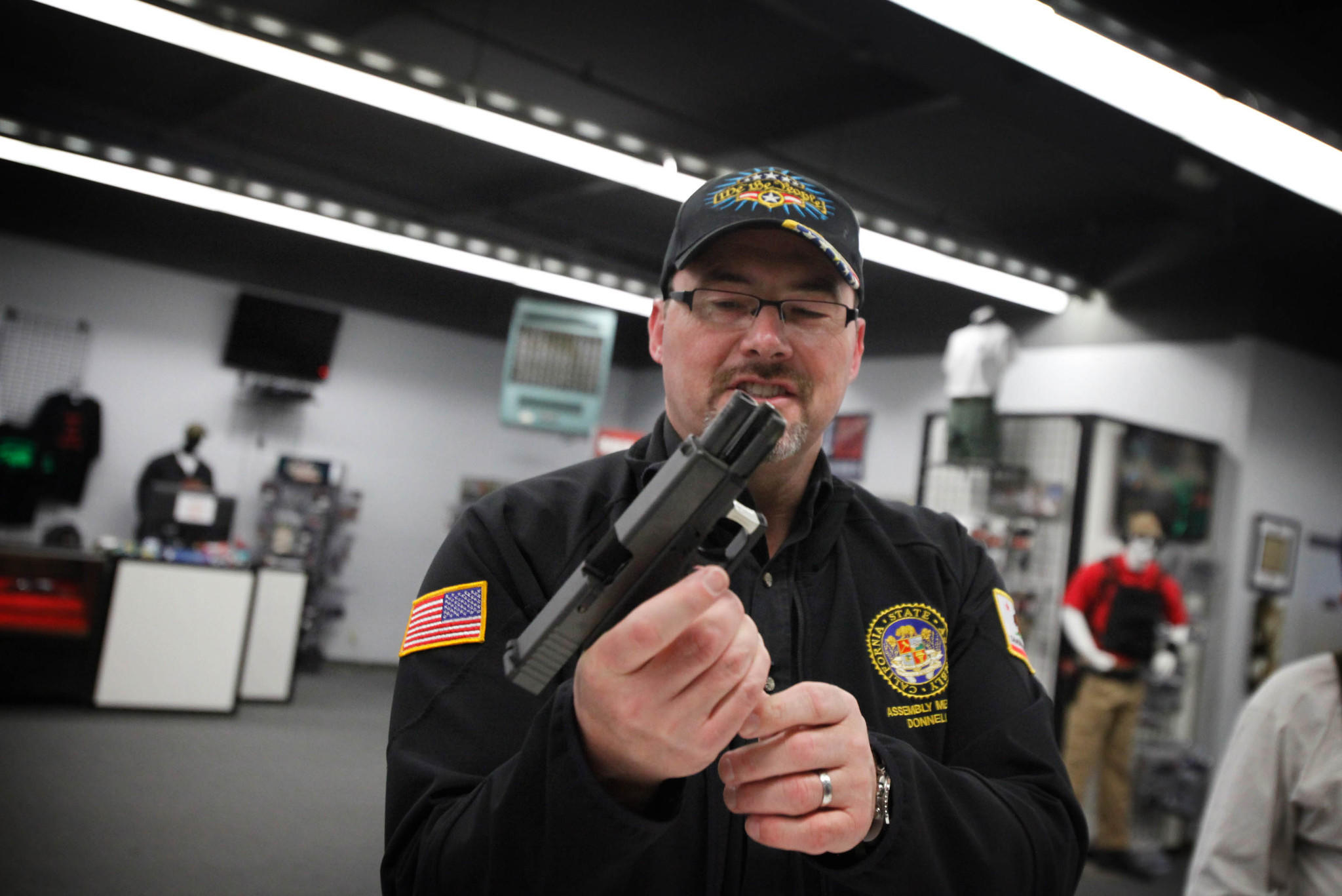 Assemblyman Tim Donnelly, a Republican candidate for governor, used borrowed firearms, including the handgun pictured here, at a gun range last week in Watsonville. His probation agreement prevents him from using weapons that are not registered to him.