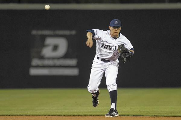 UC Irvine shortstop Chris Rabago throws out Fresno State's Manny Argomaniz at first during the season opener on Friday.
