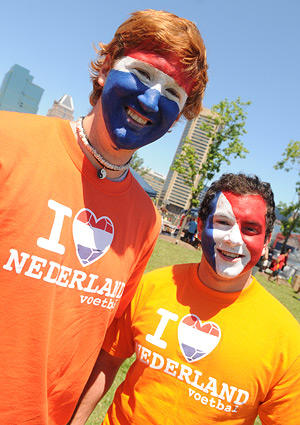 Matt Shoul, 24, of Towson, left, and Phil Motsay, 21, of Towson pose with their faces painted with the color of the Netherlands flag.