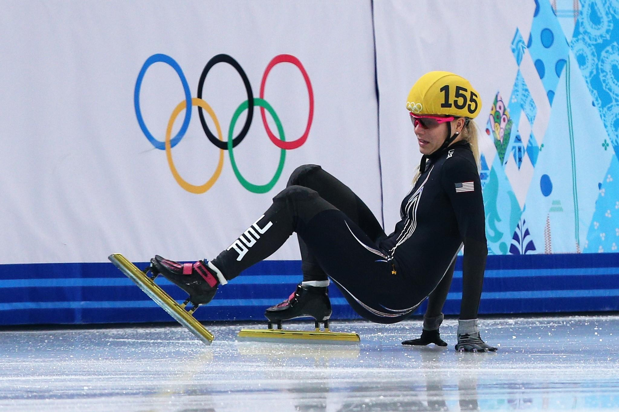 Emily Scott of the United States falls during the Ladies' 1500 m Final Short Track Speedskating.
