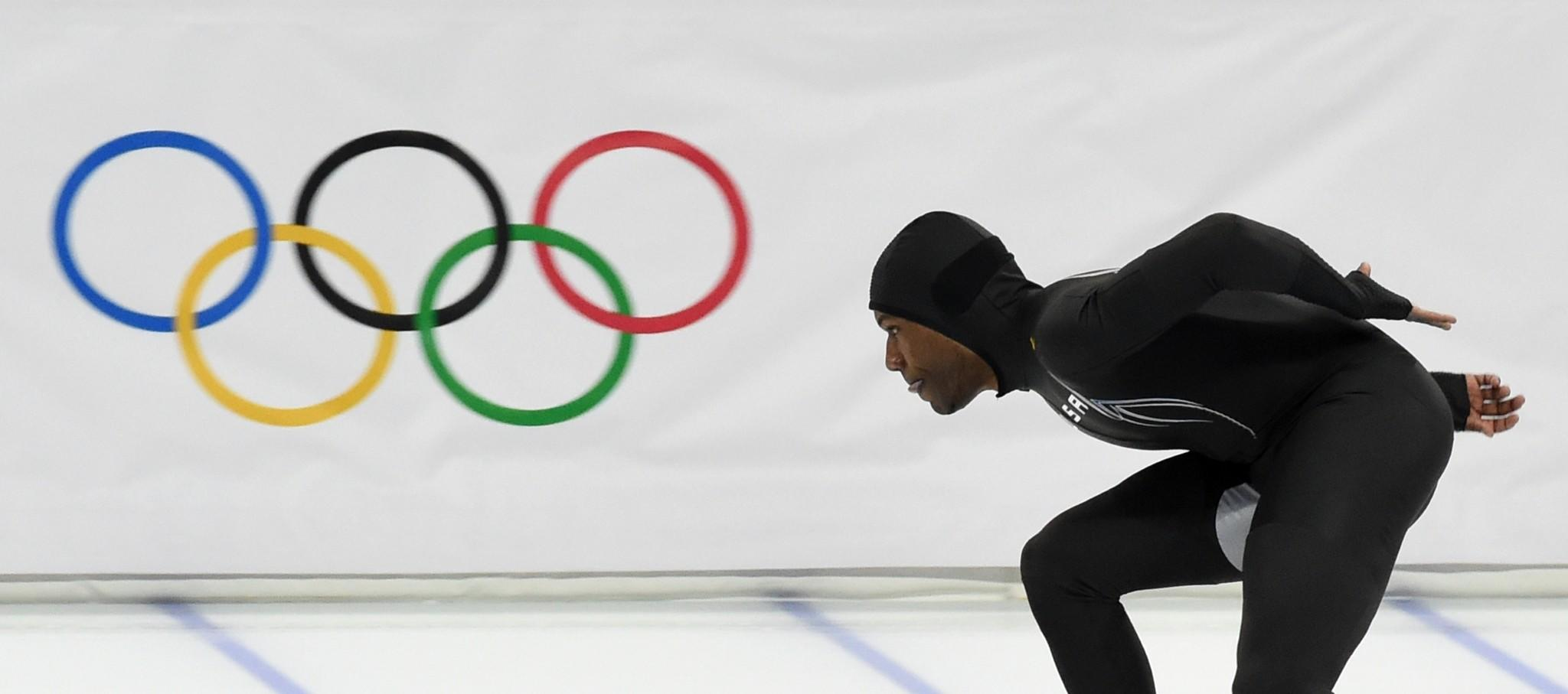 Shani Davis competes in the the Men's Speed Skating 1000 m at the Adler Arena during the Sochi Winter Olympics on February 12, 2014.