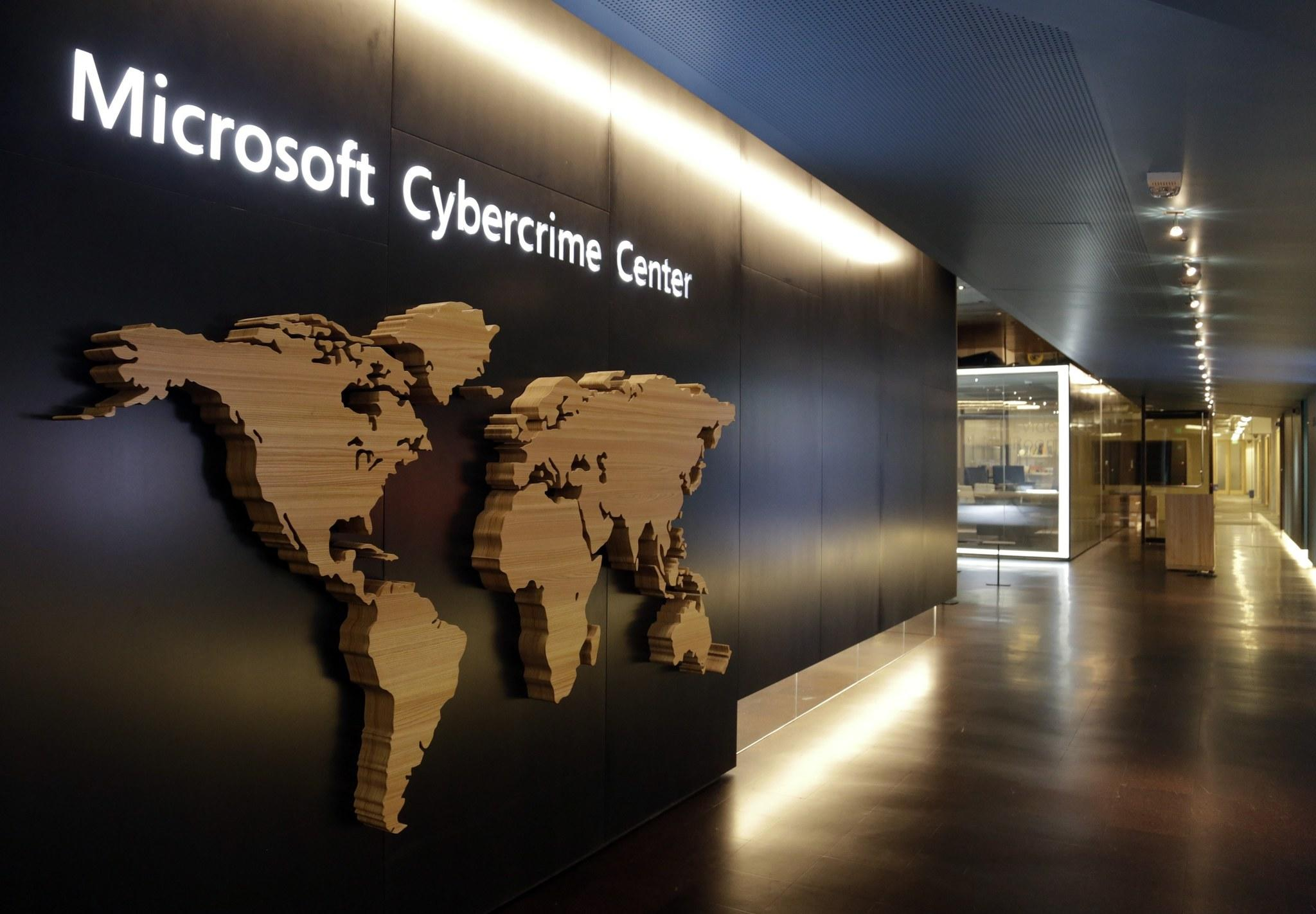 A sign is pictured in the hallway of the Microsoft Cybercrime Center, the new headquarters of the Microsoft Digital Crimes Unit, in Redmond, Wash.