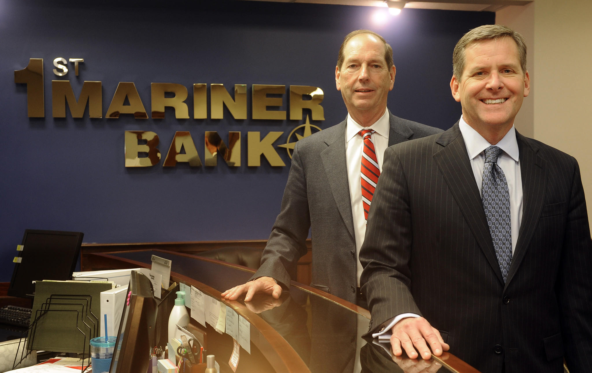 Baltimore, MD--Feb. 10, 2014--First Mariner Bank's parent is selling it to a group of investors. Jack Steil, left, is Chairman and CEO of the recapitalized bank; Robert Kunisch, right, is President and COO of the recapitalized First Mariner Bank. staff photo/Barbara Haddock Taylor