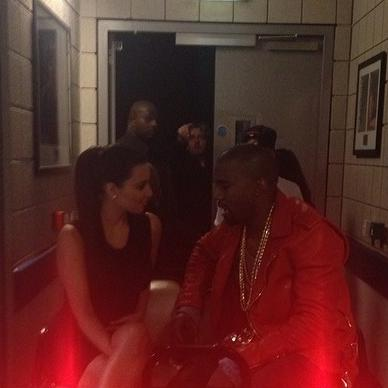 Kim Kardashian and Kanye West talk backstage at the Baltimore Arena before West's show.