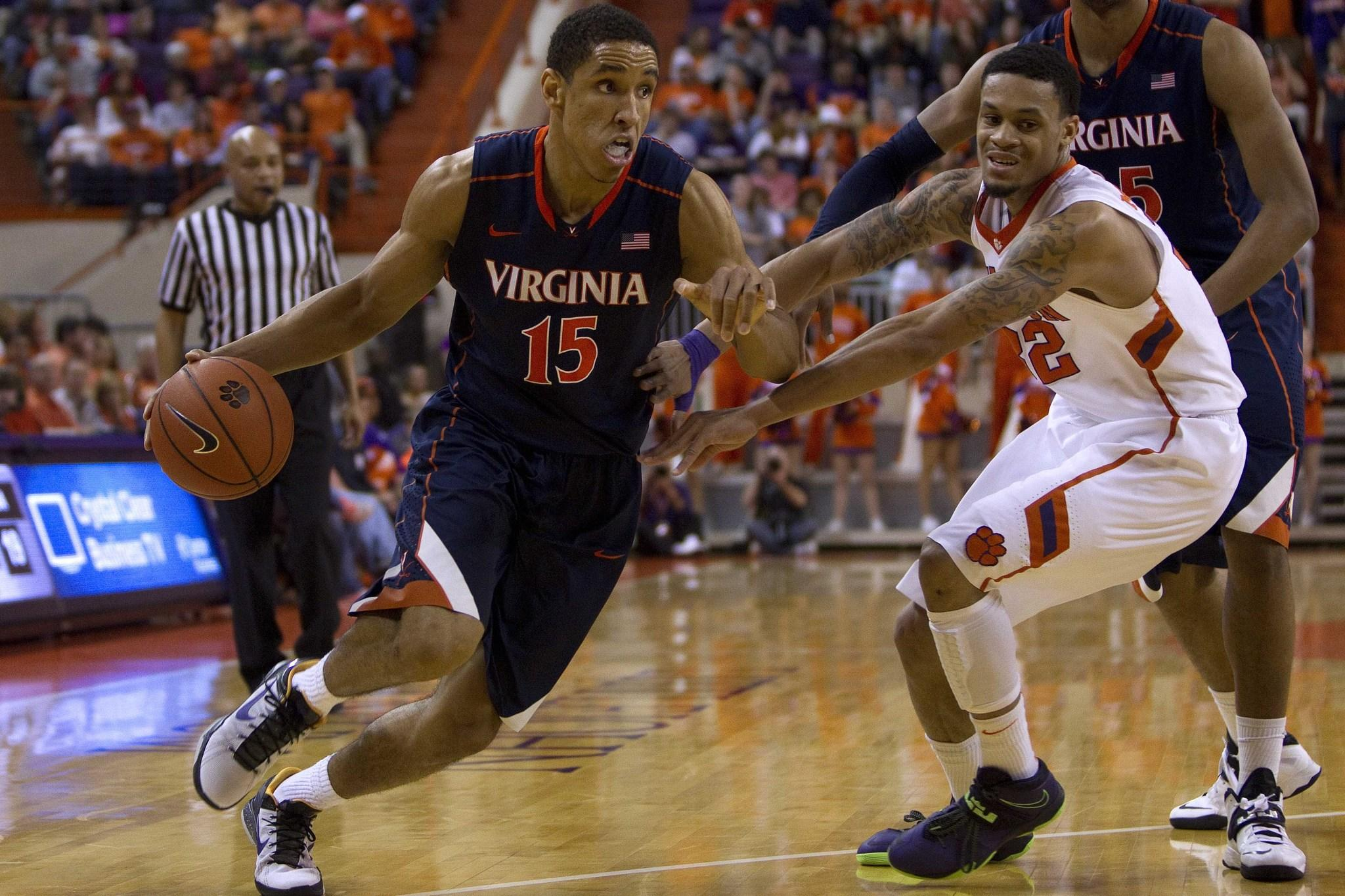 Virginia guard Malcolm Brogdon drives past Clemson forward K.J. McDaniels on Saturday in Clemson, S.C.