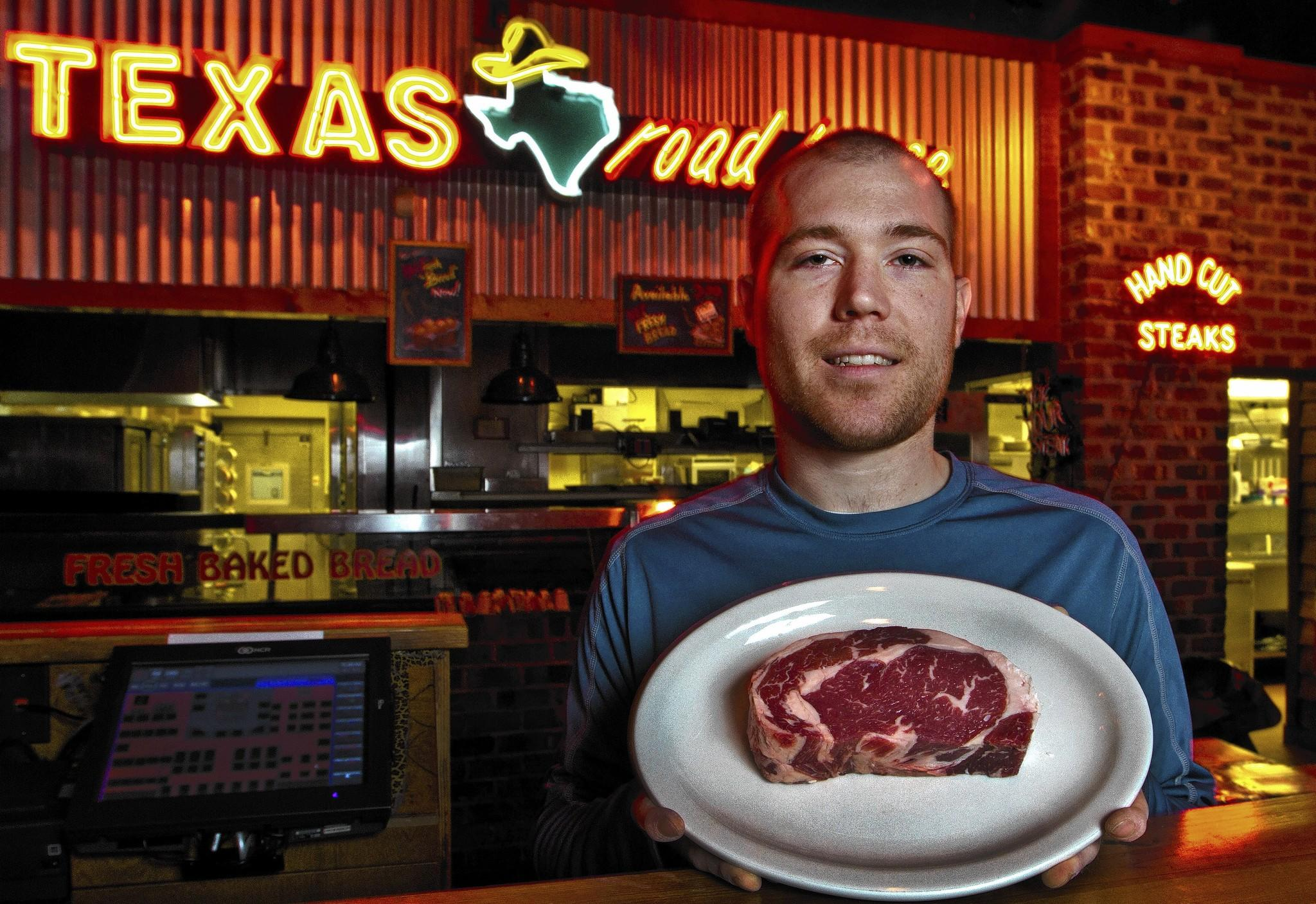 Adam Fraking cuts steaks for Texas Roadhouse and is competing in a national meat-cutting competition sponsored by the restaurant chain. He won the state level and will travel to Florida Feb. 24 to compete on the national level. Adam Fraking cut some Ribeye steaks this morning for Texas Roadhouse to use today.