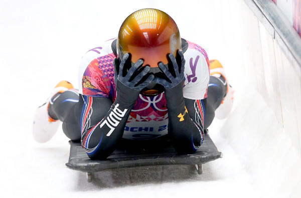 American slider John Daly reacts after his final skeleton run on Saturday at the Sochi Olympics, where he fell from fourth to 13th after a bad start.