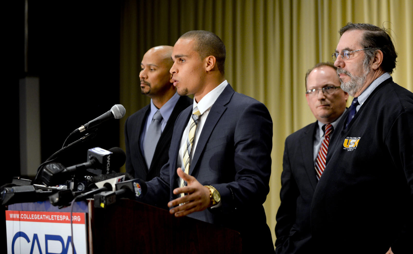 (From left to right) CAPA president Ramogi Huma, Northwestern University quarterback Kain Colter, United Steelworkers (USW) national political director Tim Waters, and United Steelworkersm (USW) president Leo W. Gerard during a press conference for CAPA College Athletes Players Association at Hyatt Regency.