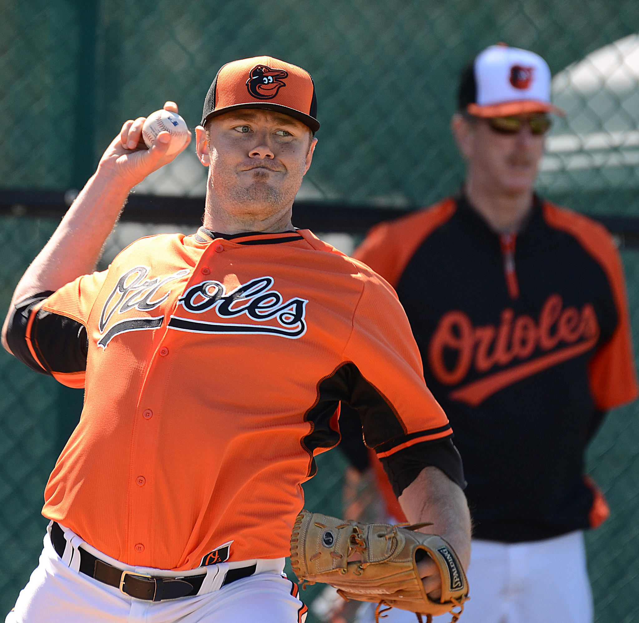 Orioles pitcher Chris Tillman throws a pitch during Friday's workout at Ed Smith Stadium.