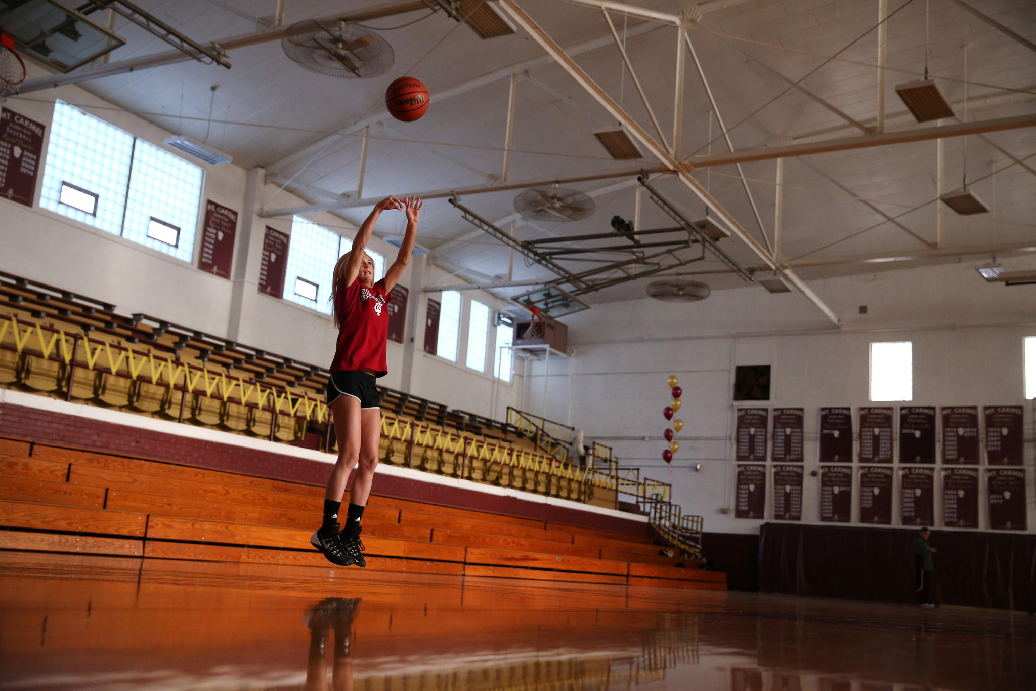 Tyra Buss, of Mount Carmel in downstate Illinois, practices her three-point shot hours before a game against Boonville on Thursday, February 6, 2014.