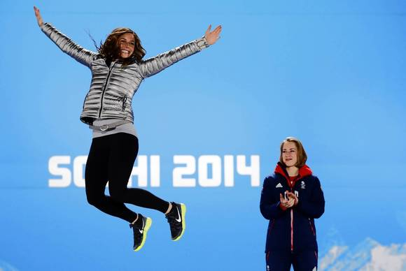 U.S. silver medalist Noelle Pikus-Pace (left) poses on the podium as Great Britain's gold medalist Elizabeth Yarnold looks on during the women's skeleton medal ceremony.