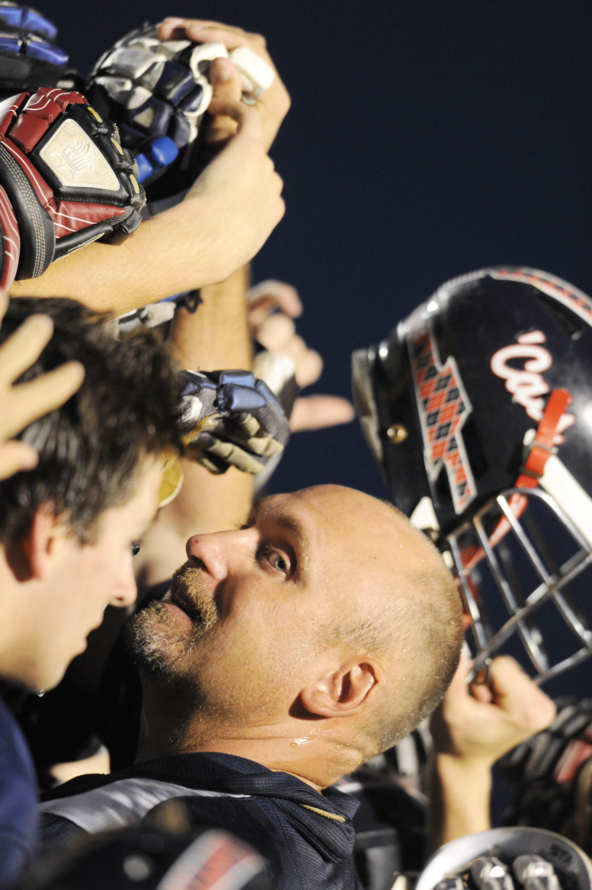 Bel Air head coach Scoop Kelly celebrates with his team after defeating Howard in the boys lacrosse regional championship game at Howard High School in 2012. The win was Kelly's 100th in his high school coaching career.