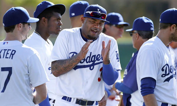 Dodgers outfielder Carl Crawford laughs with his teammates during a spring training session Friday. Crawford is staying positive heading into his second season with the Dodgers.