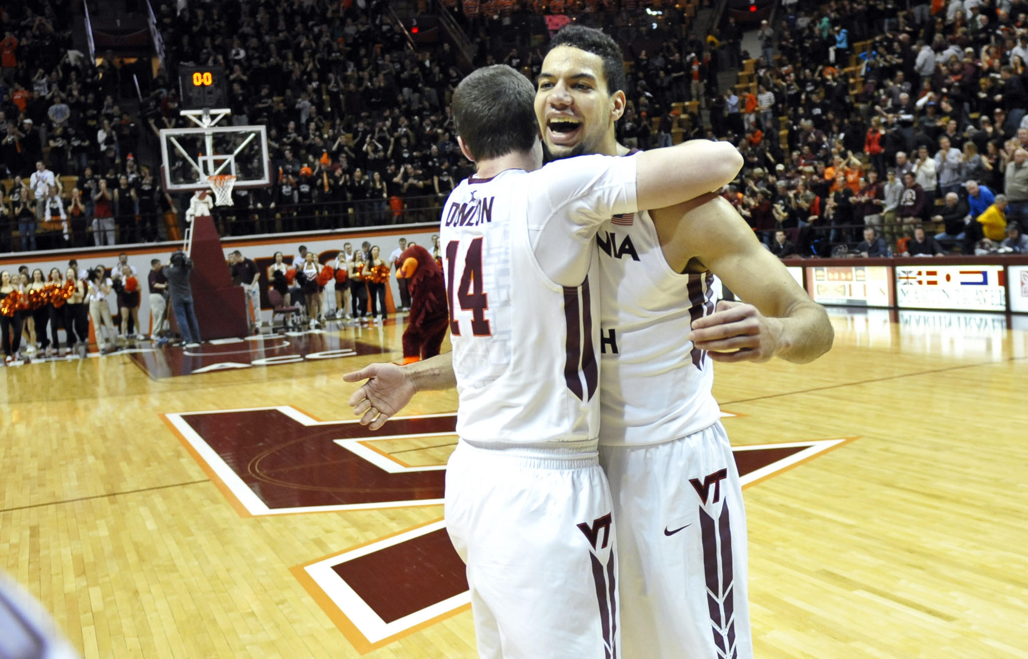 Virginia Tech's Joey van Zegeren and Greg Donlon (14) celebrate after the Hokies' 52-45 win against Miami on Saturday in Blacksburg.