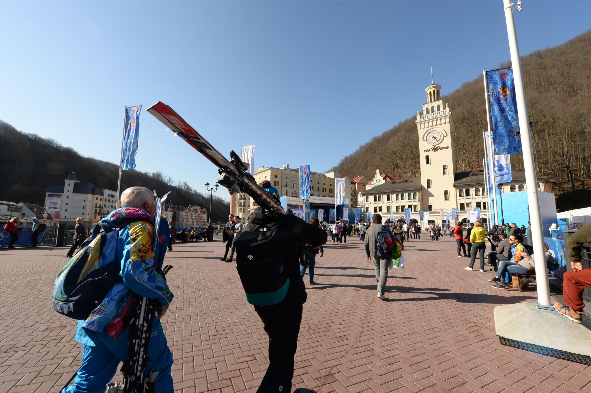 People carrying skis in the village of Rosa Khutor during the Sochi 2014 Olympic Winter Games.