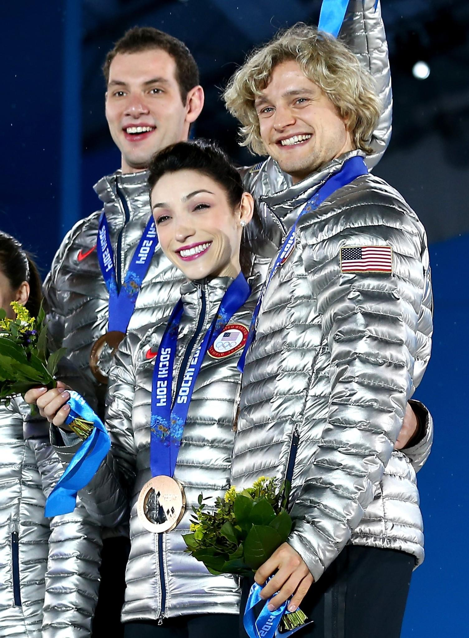 (L-R) Bronze medalists Simon Shnapir, Meryl Davis and Charlie White of the United States celebrate during the medal ceremony for the Team Figure Skating Overall.