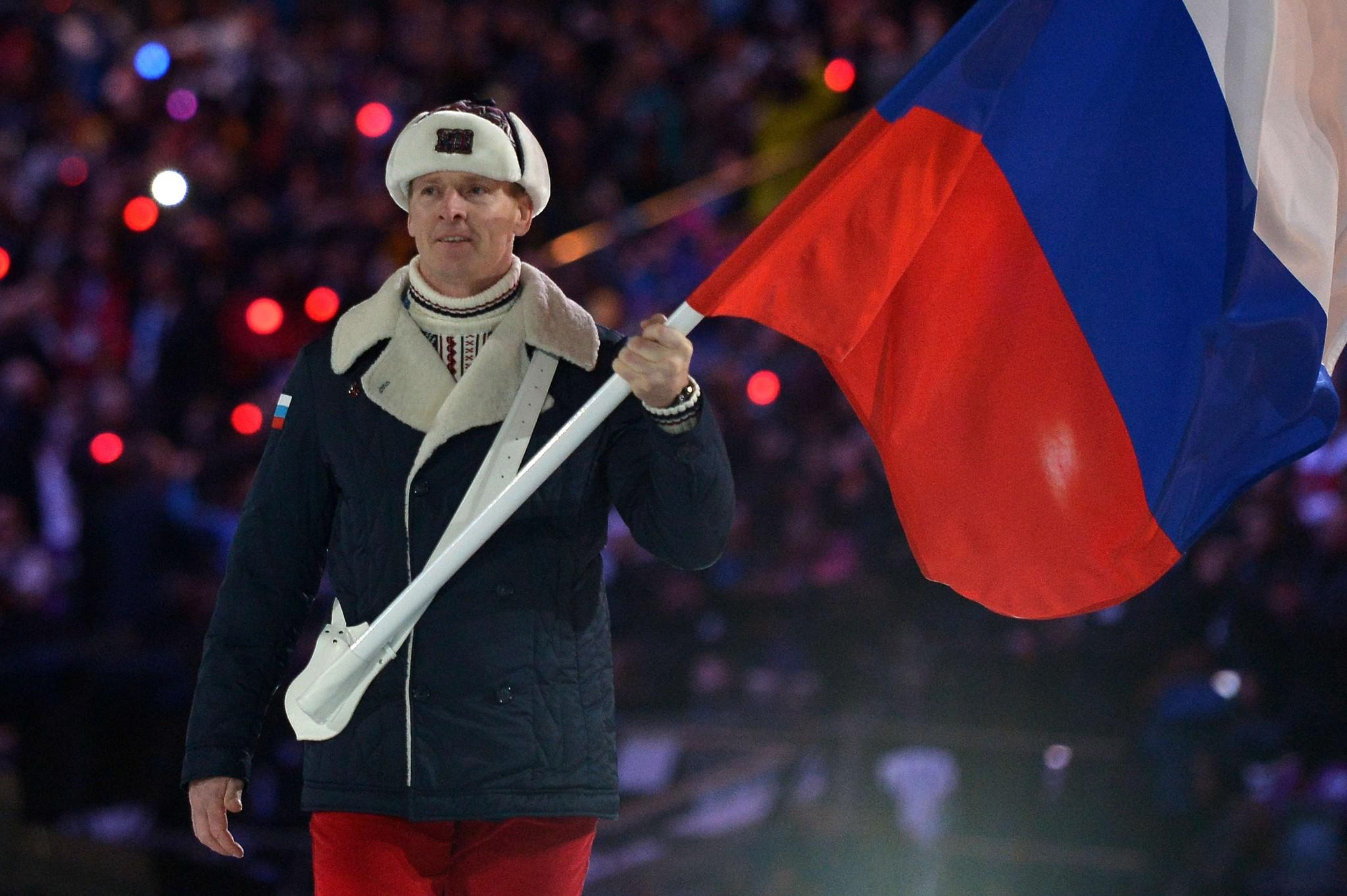Russia's flag bearer, bobsledder Alexander Zubkov leads his national delegation during the Opening Ceremony of the Sochi Winter Olympics at the Fisht Olympic Stadium on February 7, 2014 in Sochi.