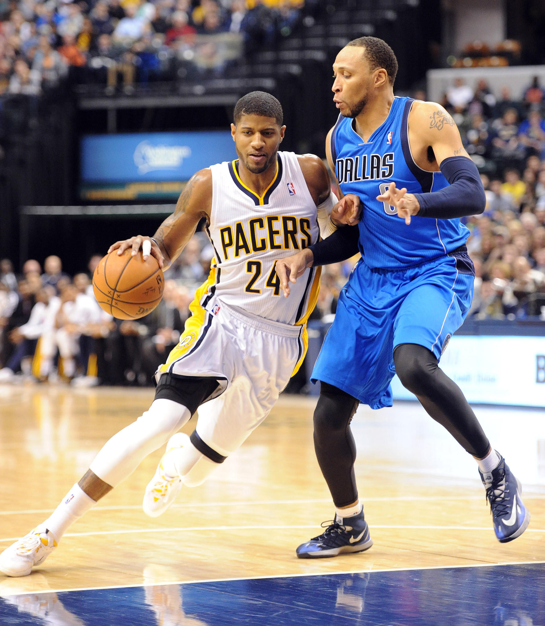 Indiana Pacers guard Paul George (24) drives against Dallas Mavericks forward Shawn Marion (0) at Bankers Life Fieldhouse.