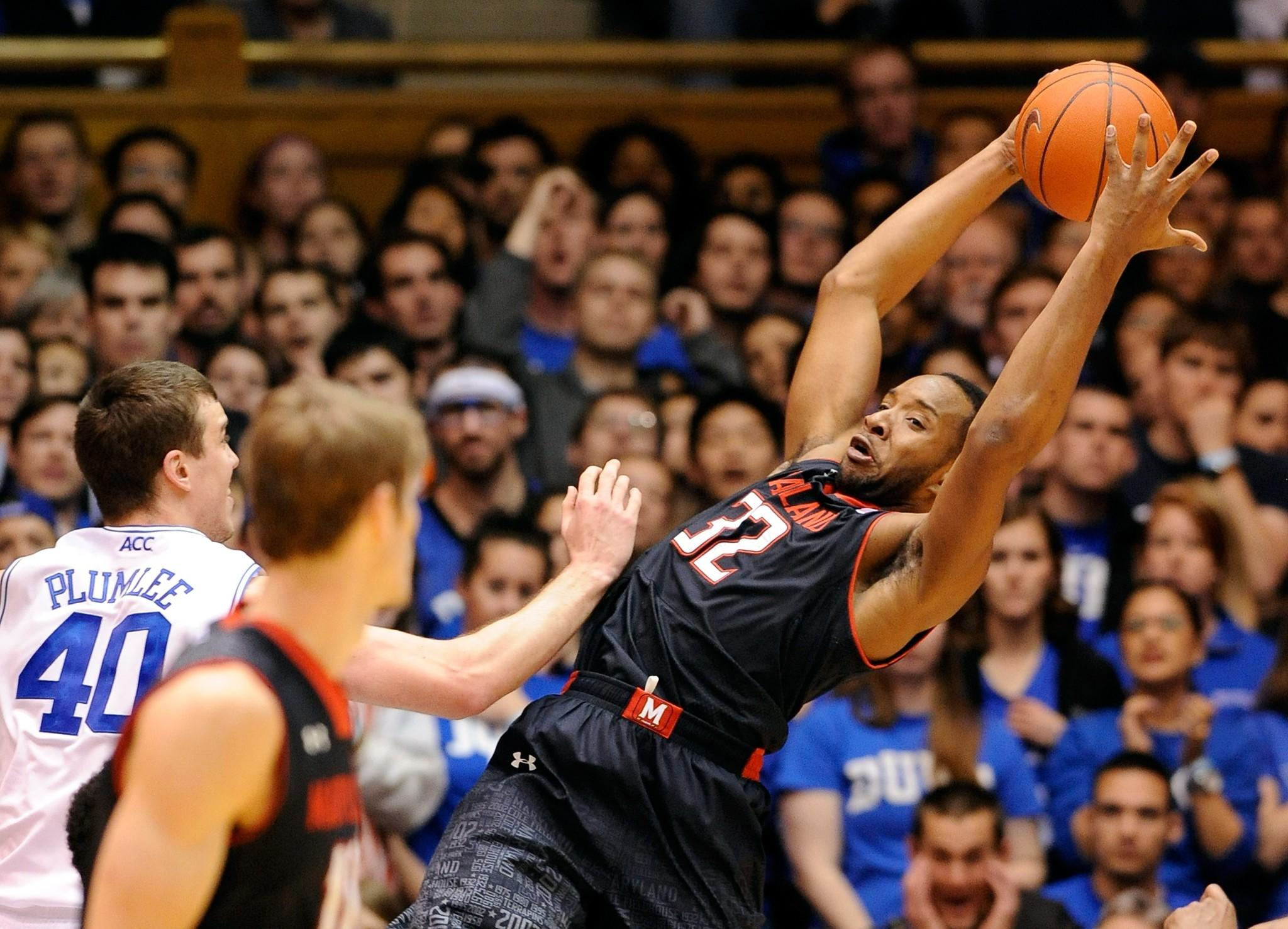 Maryland's Dez Wells pulls down a rebound against Duke's Marshall Plumlee.