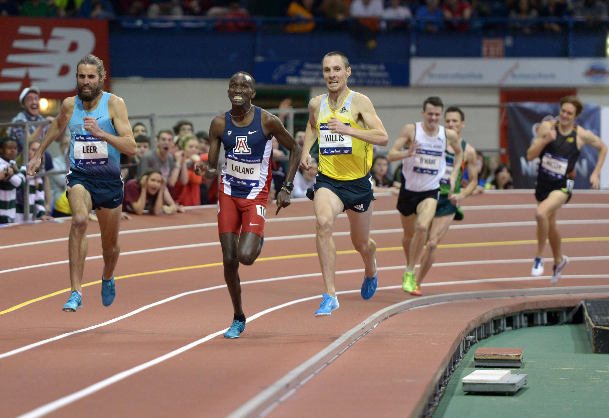 Feb 15, 2014; New York, NY, USA; Will Leer (USA) defeats Lawi Lalang of Arizona (KEN) and Nick Willis (NZL) to win the Wanamaker Mile in 3:52.47 in the 107th Millrose Games at The Armory. Mandatory Credit: Kirby Lee-USA TODAY Sports