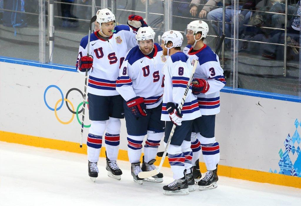 From left to right, James van Riemsdyk, Phil Kessel, Joe Pavelski and Cam Fowler celebrate Kessel's third goal.