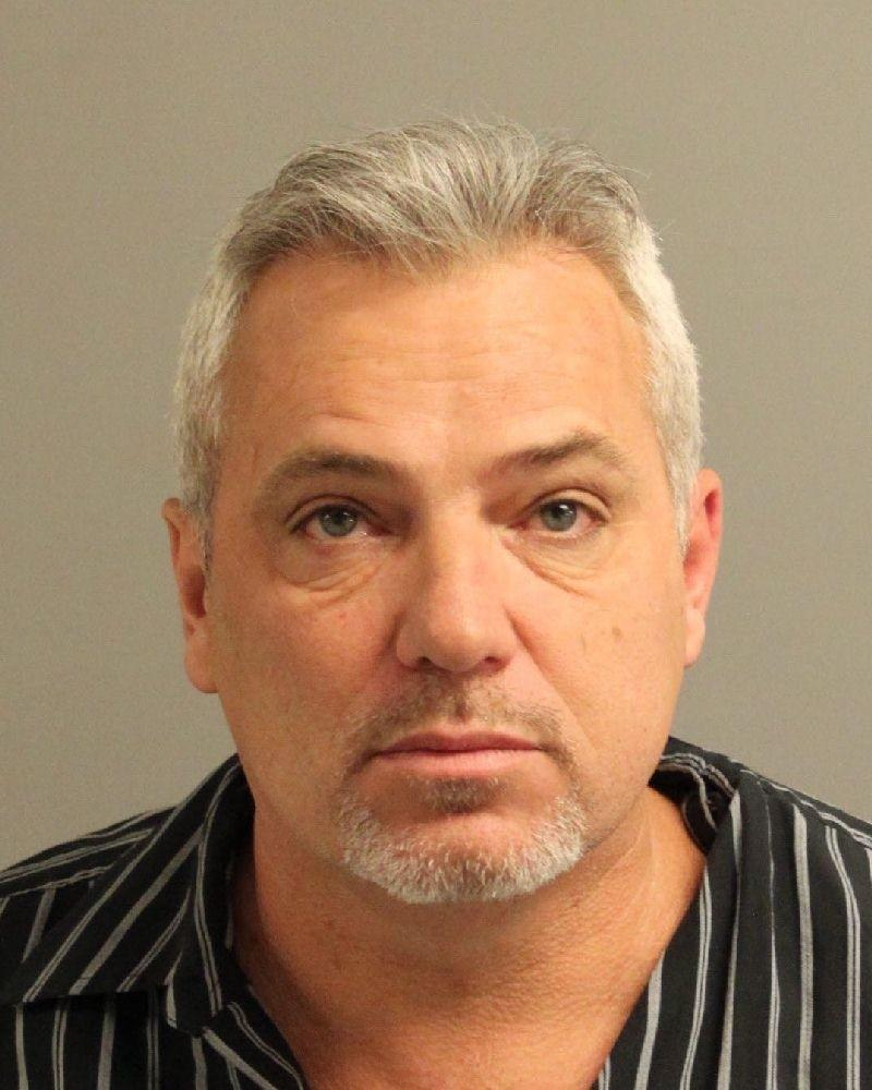 Timothy Zois, 47, of Harwood charged with assault after Anne Arundel County police said he got into a fight with another man over a piece of trash.