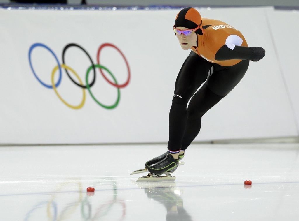 Sochi Olympics: Jorien ter Mors wins women's 1,500-meter ...