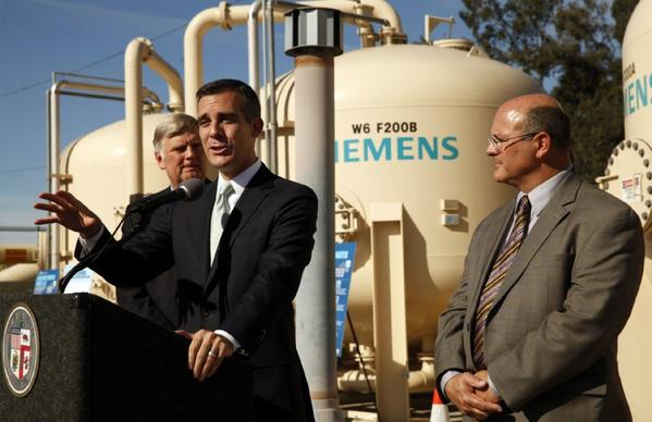 Mayor Eric Garcetti, center, with Jim McDaniel, left, Interim General Manager of the DWP, and Marty Adams, right, Head of Water Operations at DWP, at a news conference last week to  discuss the city's response to the dro
