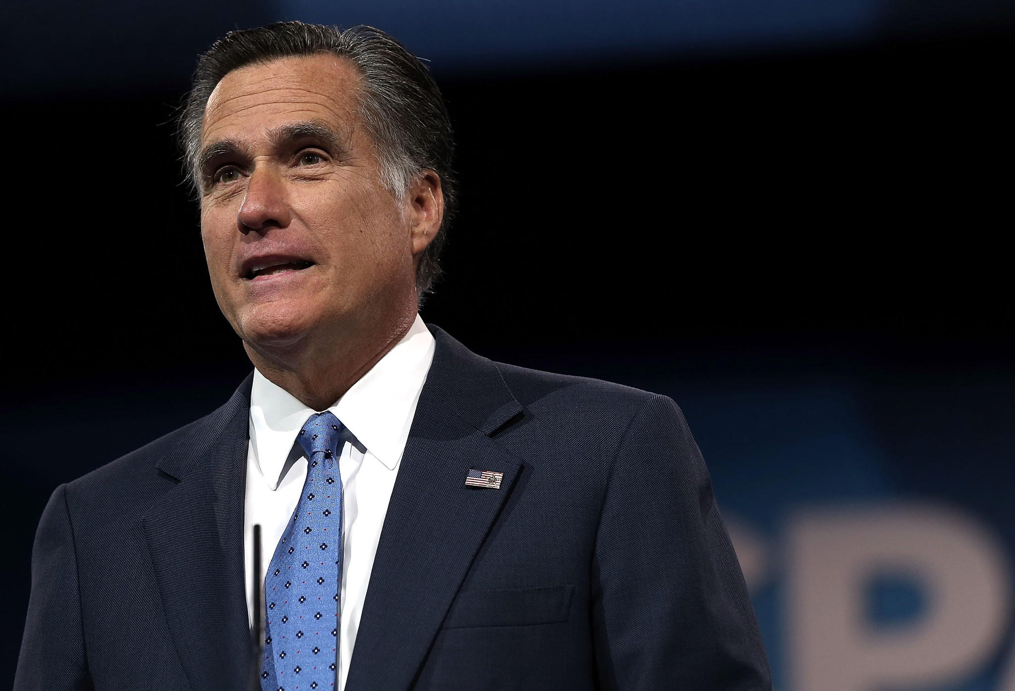 Former Republican presidential candidate and former Massachusetts Governor Mitt Romney delivers remarks during the second day of the 40th annual Conservative Political Action Conference (CPAC).