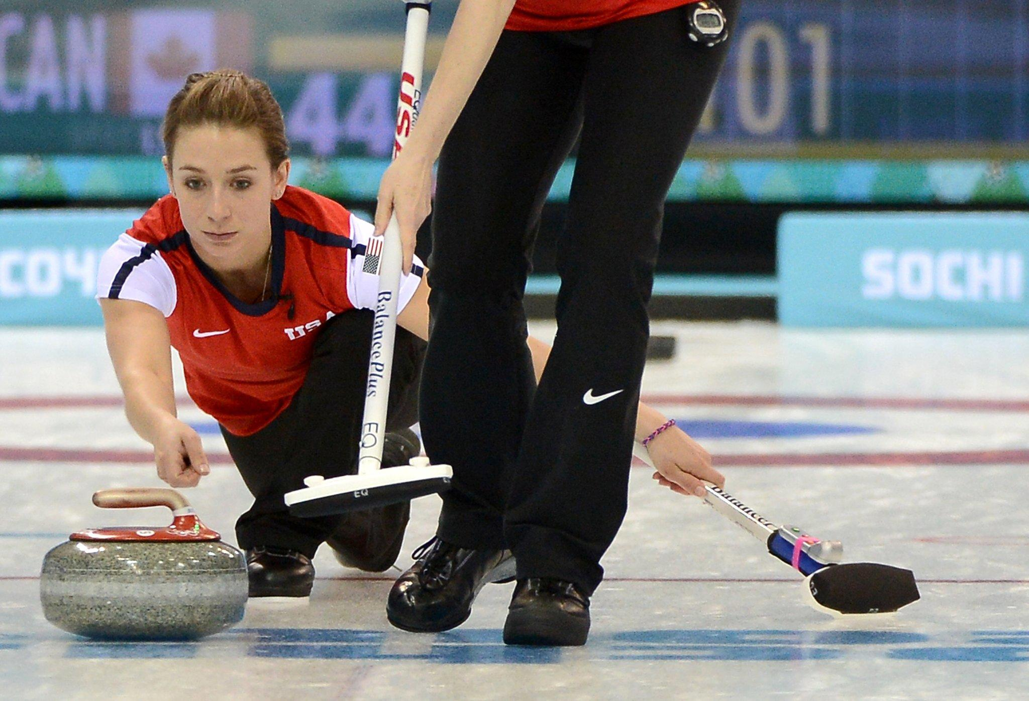 The USA's Jessica Schultz releases a stone during the game against Canada in the women's curling competition at the Ice Cube Curling Center.
