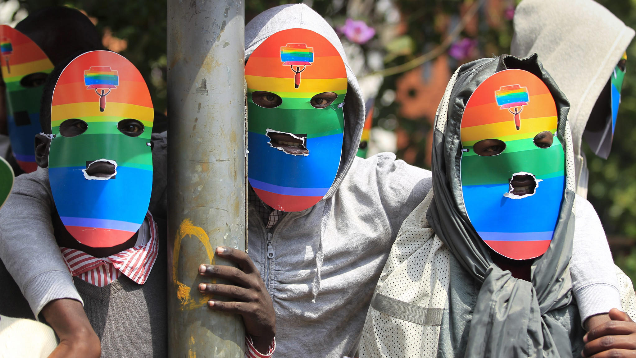 "Masked Kenyan supporters of the LGBT community stage a protest against Uganda's anti-gay bill in Nairobi. Ugandan President Yoweri Museveni has been warned by President Obama that signing an anti-gay law would ""complicate"" the U.S. relationship with the east African country."