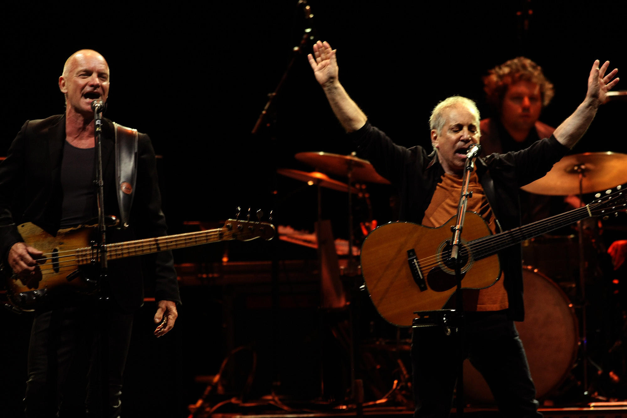 Sting, left, and Paul Simon perform a joint concert Saturday night at the Forum in Inglewood.