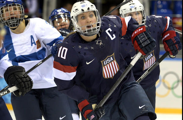 U.S. captain Meghan Duggan (10) keeps her eyes on the puck during a preliminary-round game against Finland last week.