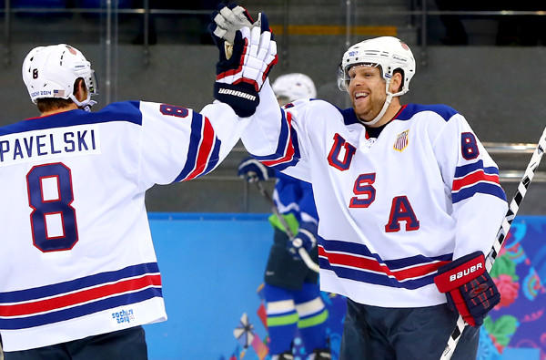 U.S. forward Phil Kessel is congratulated by teammate Joe Pavelski after scoring his second goal in the first period against Slovenia in a preliminary-round game of the Sochi Olympics on Sunday at Shayba Arena.