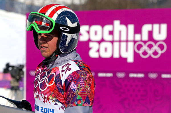 American Trevor Jacob takes a break between Sochi Olympics practice runs for the snowboard cross at the Rosa Khutor Extreme Park.