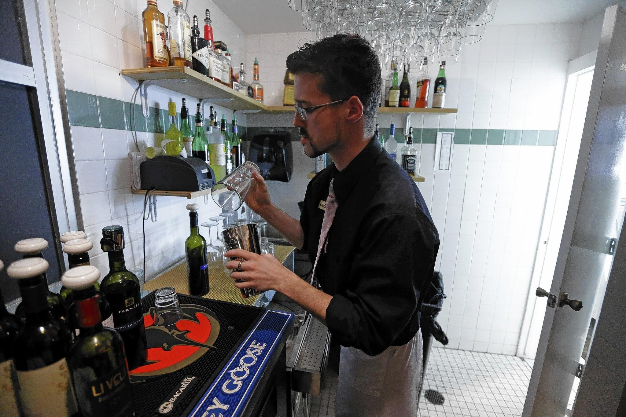 An Alcoholic Drink Is Prepared Out Of View Of Customers, In Compliance With  State Law