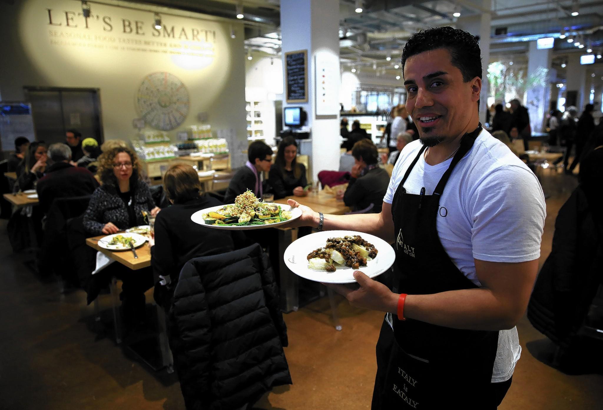 Mauricio Paredes serves meals at Le Verdure, a vegetarian restaurant at Eataly, an Italian marketplace.