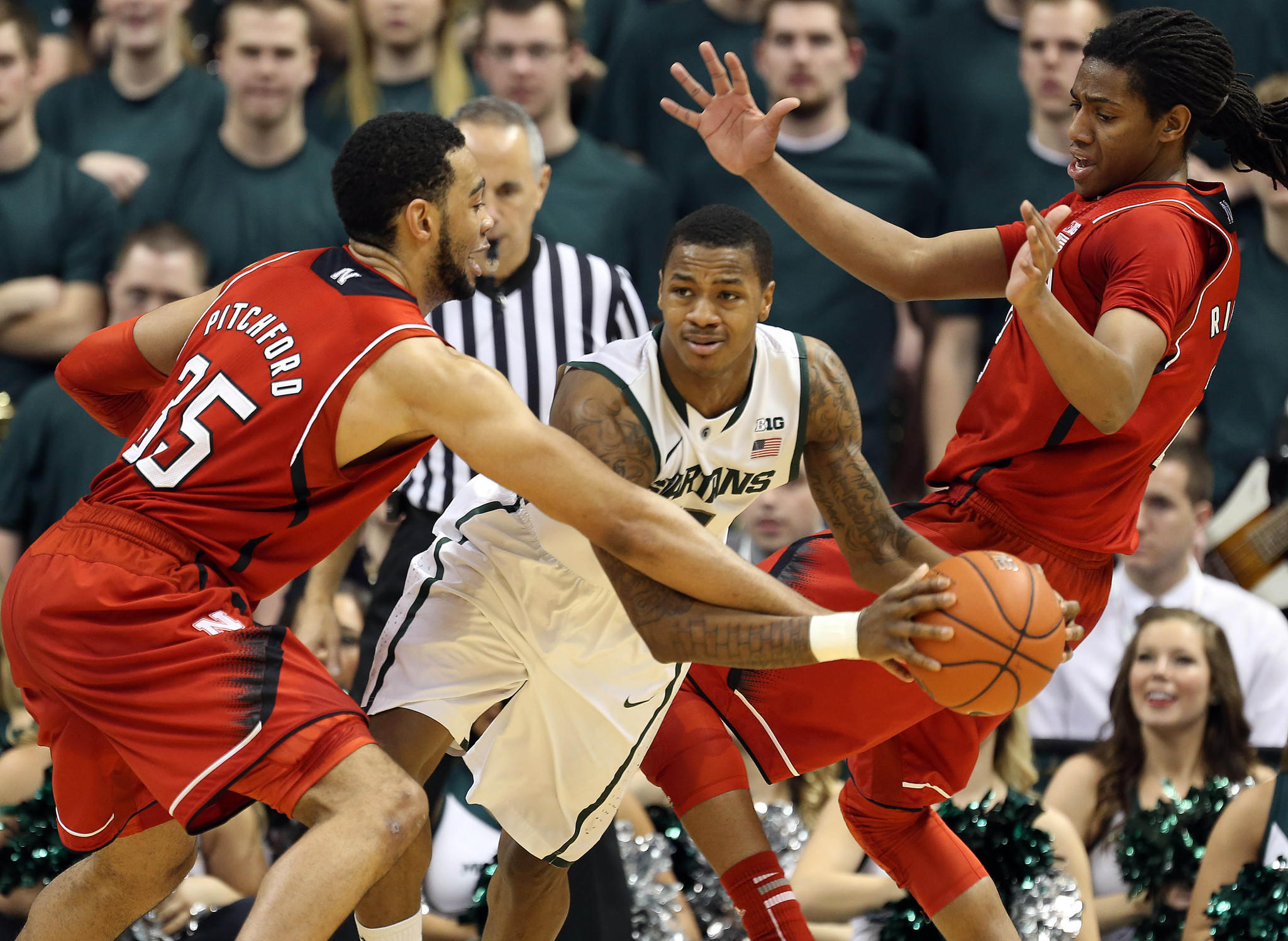Michigan State's Keith Appling is fouled by Nebraska's Walter Pitchford during the first half at Jack Breslin Student Events Center.