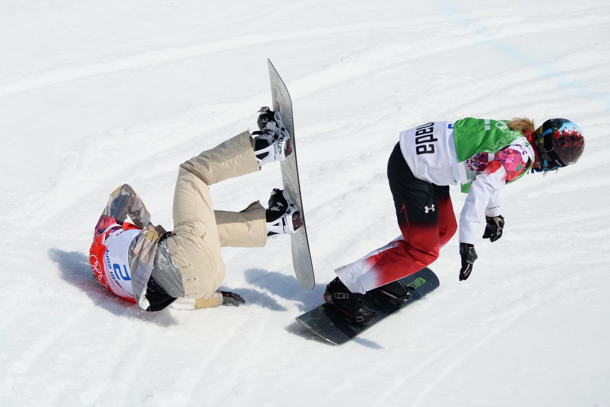 Lindsey Jacobellis crashes as Canada's Dominique Maltais passes in the semifinals run.