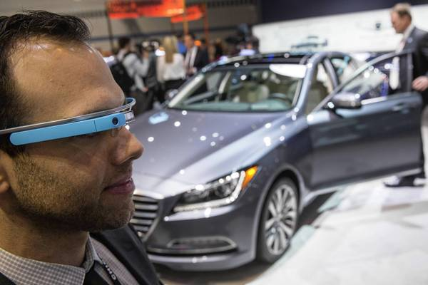 Hyundai PR representative Rob Lescaille wears a Google Glass device to emphasize its integration with technology in the new Genesis at the 2014 Chicago Auto Show at McCormick Place.