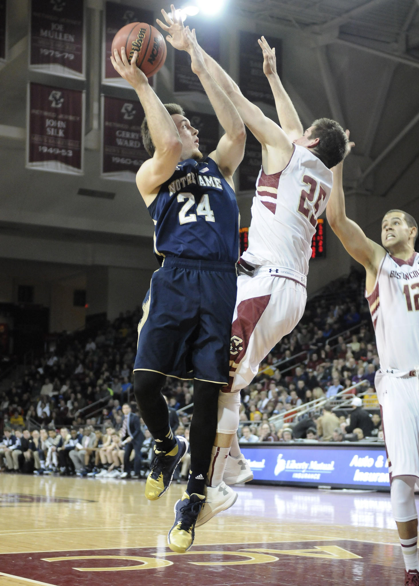 Pat Connaughton shoots the ball over Boston College's Joe Rahon during the first half at Silvio O. Conte Forum.