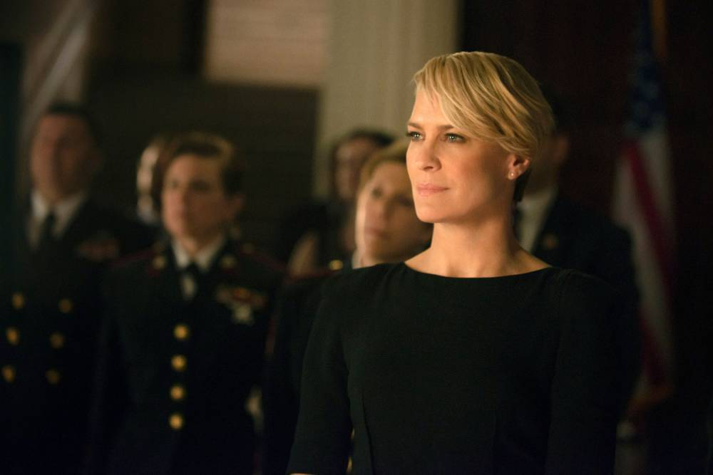 Robin Wright attends a very dramatic military ceremony.