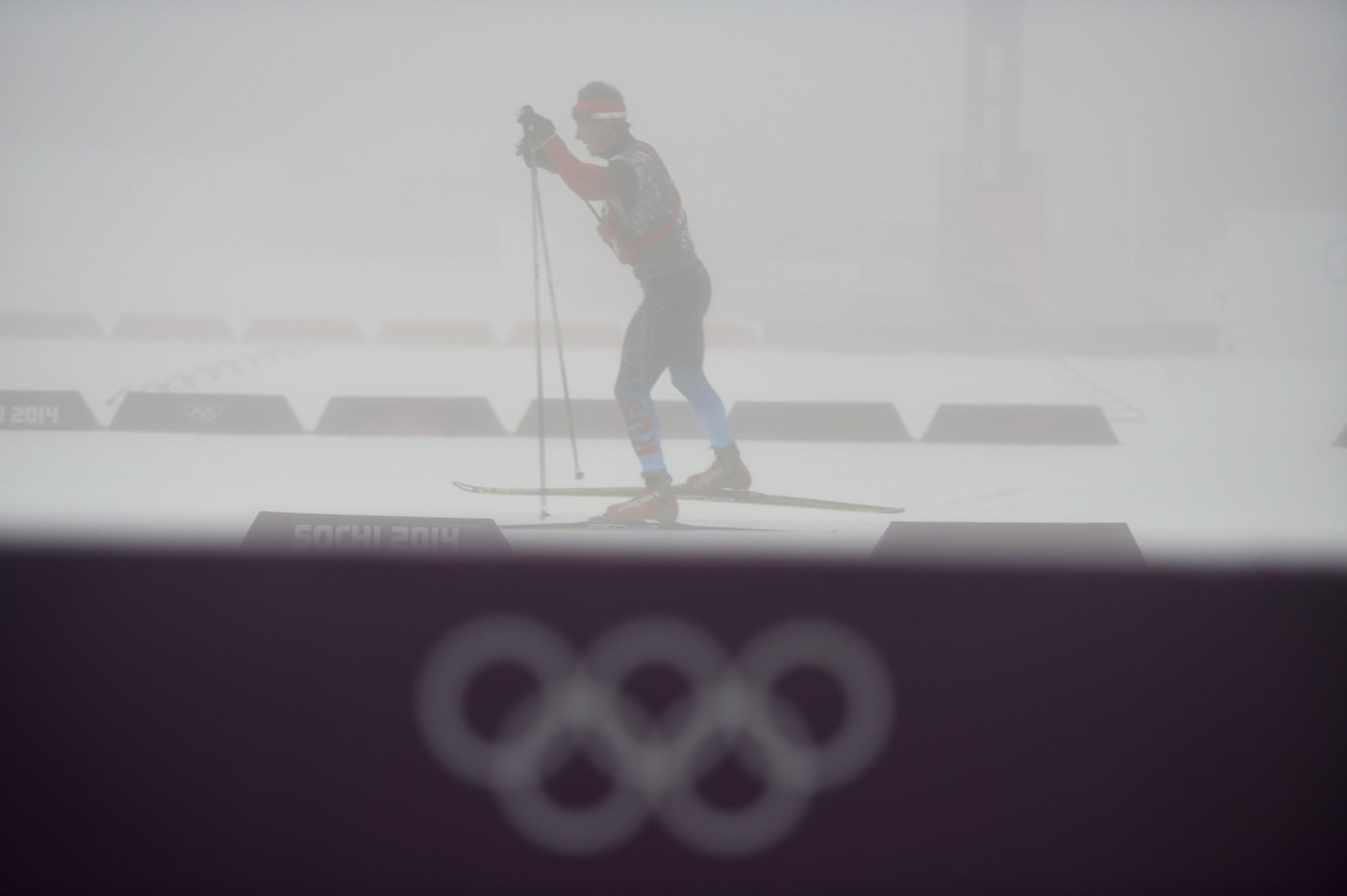 A Russian team member skis as the men's biathlon 15 km Mass Start has been postponed for the second time due to bad weather condition at the Laura Cross-Country Ski and Biathlon Center.