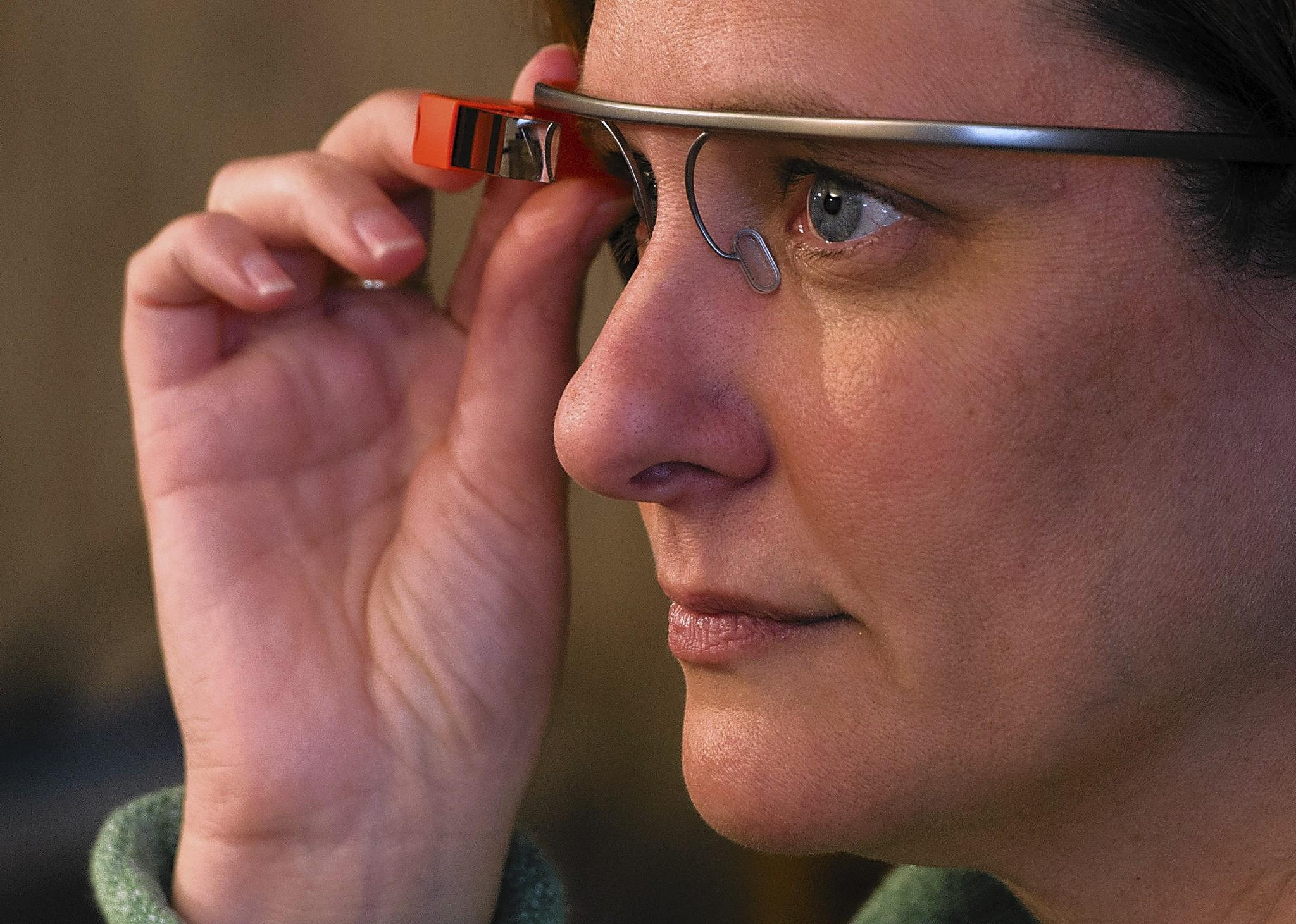 Sarah Brendle tests Google Glass in her Pennsburg home. Brendle has ALS, and just received a beta version of Google Glass to wear, test and make recommendations back to Google.