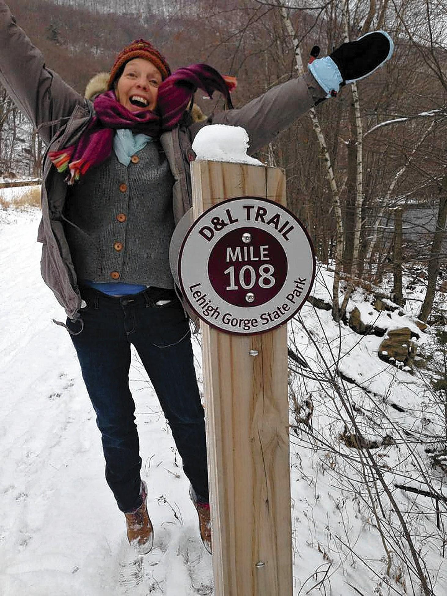 Deanna Jones of East Stroudburg celebrates a milestone on the D&L Trail.