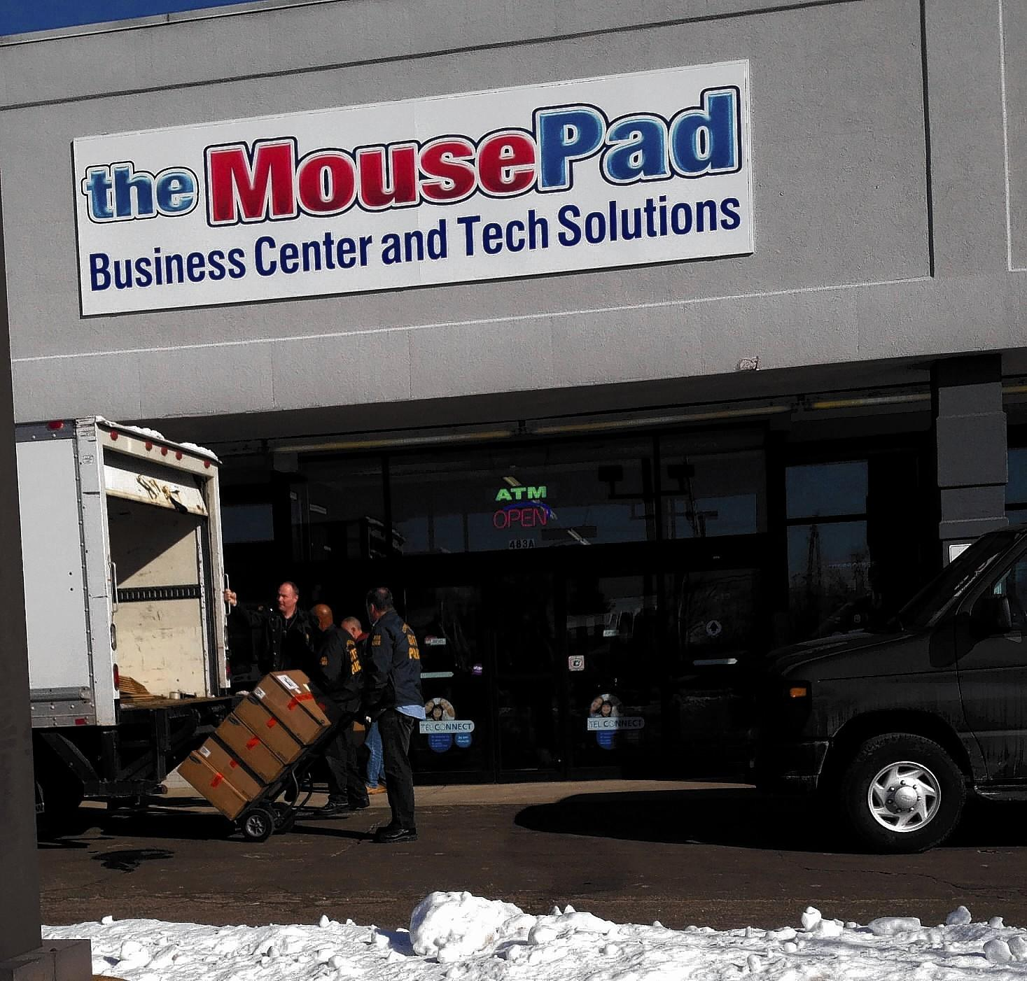 State police loading a truck with 200 items of evidence (computers) from the MousePad in Enfield.
