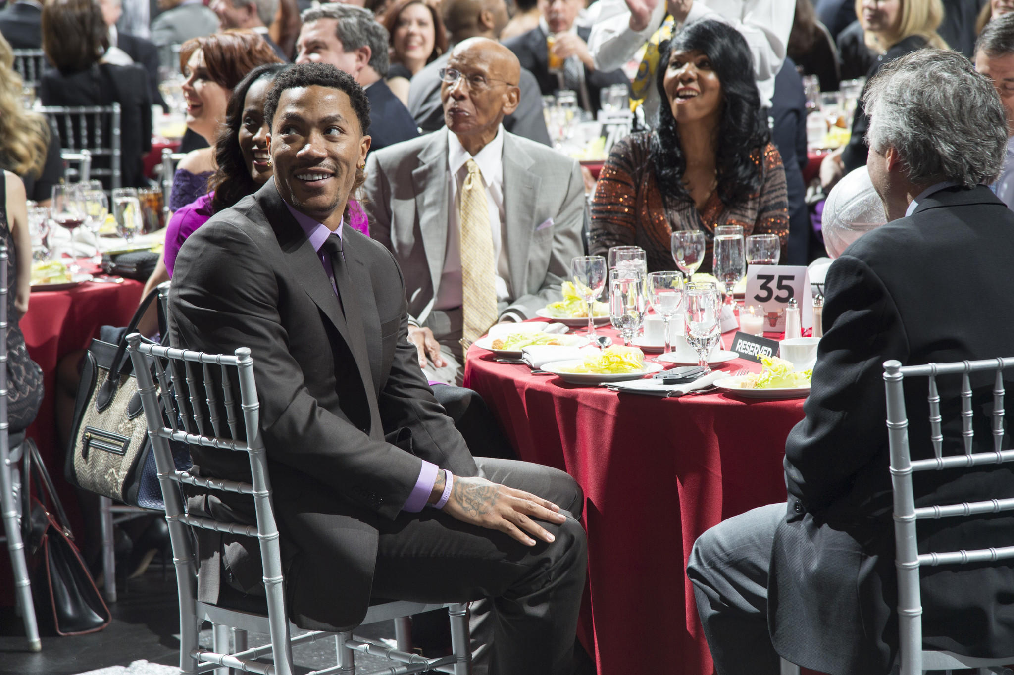 """The Bulls' Derrick Rose and Cubs legend Ernie Banks attend """"An Evening with the Bulls"""" fundraiser Feb. 12, 2014 at the United Center."""