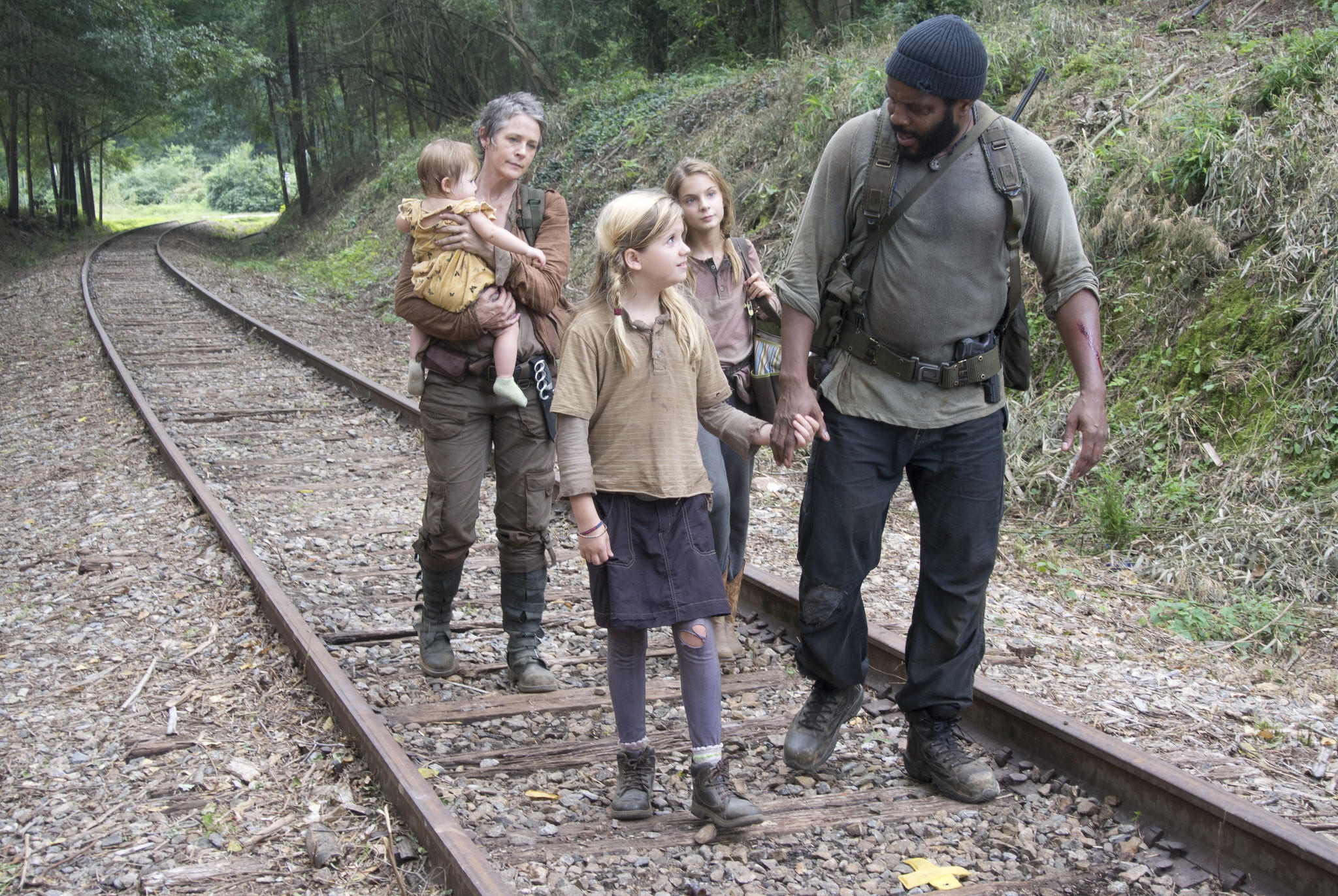 "From left: Carol (Melissa Suzanne McBride), Penny (Kylie Szymanski), Lizzie (Brighton Sharbino) and Tyreese (Chad Coleman) in ""The Walking Dead."""